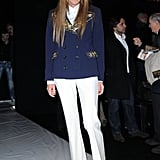 Anna Dello Russo wore yet another menswear-inspired look at the Moschino show — are you feeling those gilded flatforms?