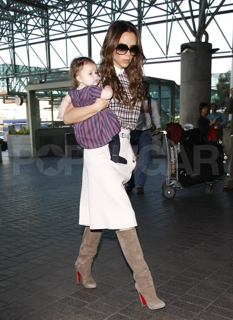 "Victoria Beckham and her daughter, Harper, put on fancy outfits yesterday to catch a flight out of LAX. The girls headed home to England, where they were seen arriving this morning. The Beckham ladies are off visiting with relatives and taking care of UK business while David and Harper's brothers stay in California. David showed Cruz and Romeo the Black Friday ropes just two days ago, taking them to see what the sales were at a local Brooks Brothers.  Harper seems to have already developed a taste for nice clothes too — she was wearing a pair of Chloe tights! Victoria, meanwhile, was in her favorite pair of Christian Louboutin boots. The mother of four spoke recently about raising her family while managing a growing fashion empire. She said during a WWD talk earlier this month, ""There are quite a few video conferences at 5 a.m. with me in my dressing gown, holding baby . . . For me it's no different than it is for a lot of women out there. It's like juggling glass balls. I love it."""