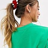 ASOS Design Holidays Scrunchie in Velvet With Pom Detail