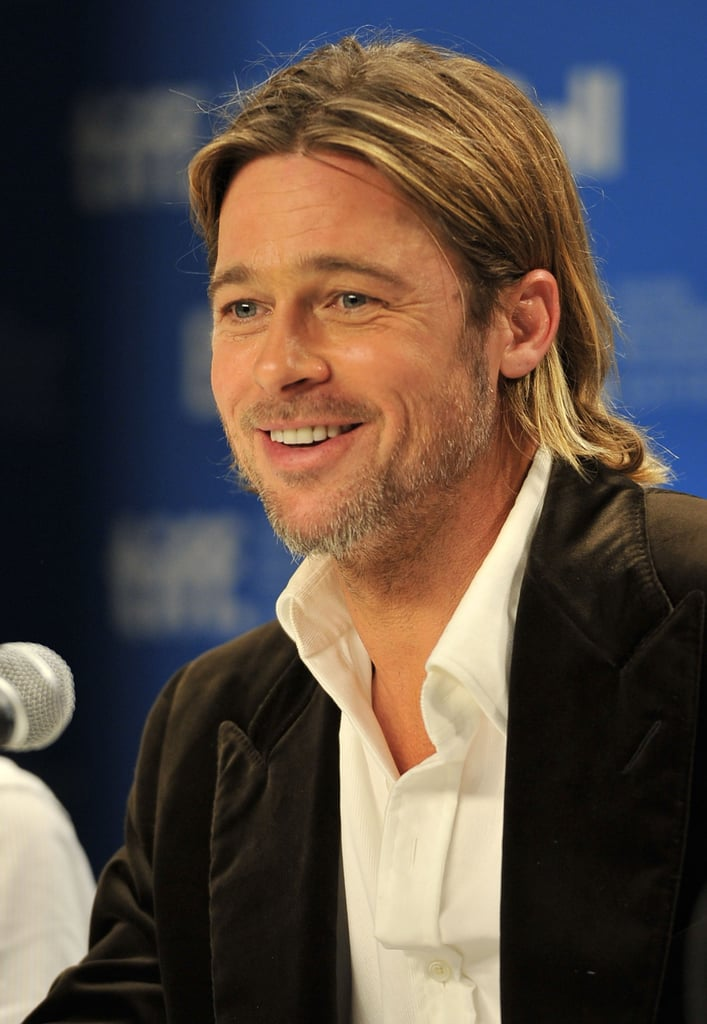Brad Pitt smiled at Toronto Film Festival.