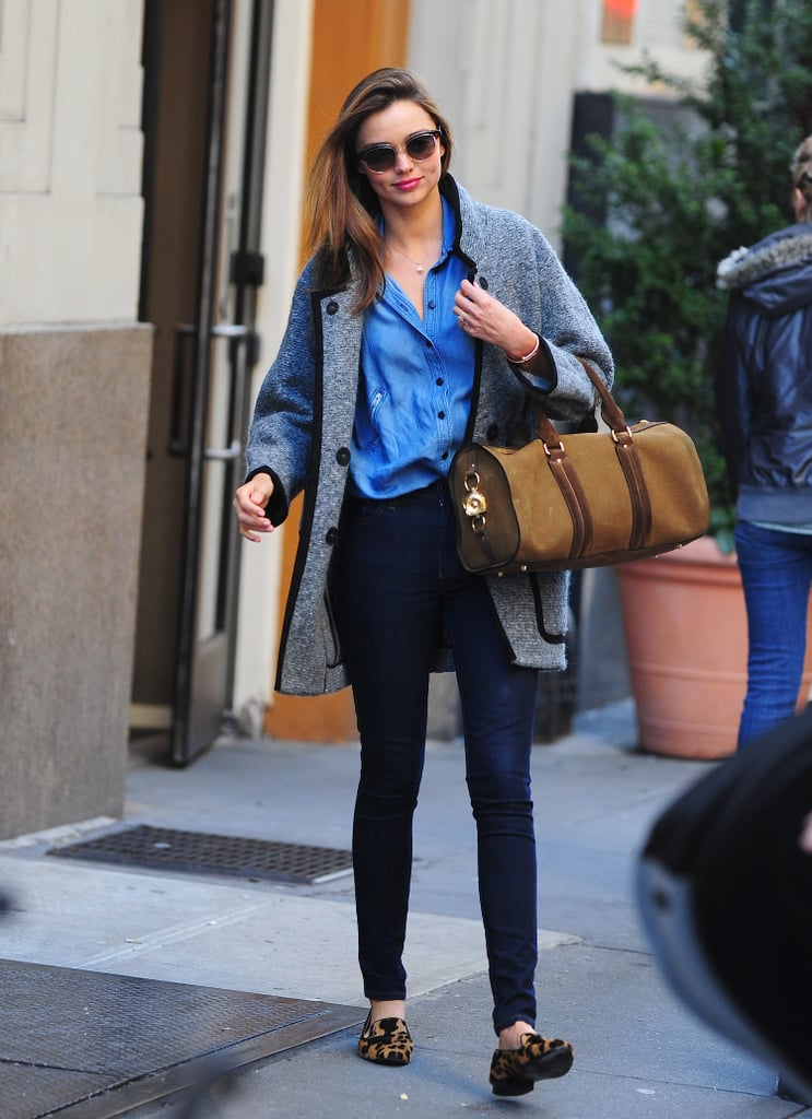 Miranda presented the perfect weekend look in her Isabel Marant coat, which complemented her denim-on-denim look, accessorized with a pair of leopard-print flats and a classic duffel bag by Burberry.