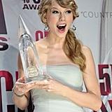 Taylor posed in the press room at the CMA Awards in November 2011.