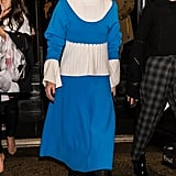 For the Prabal Gurung show, Olivia wore a matching blue set by the designer and accessorized with Prada lace-up boots.