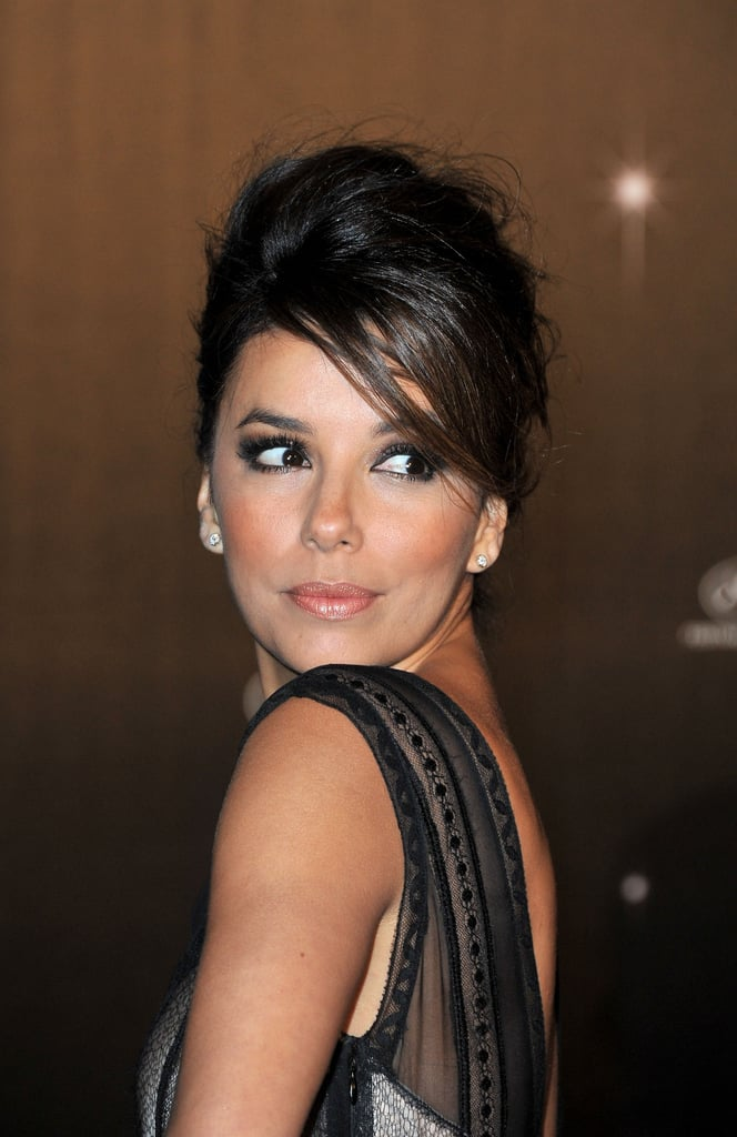 Eva Longoria gave a sexy pose at the opening night dinner for the Cannes Film Festival.