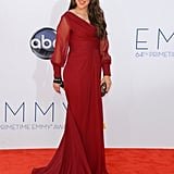 Mayim Bialik — mom to Miles, 6, and Frederick, 4 — covered up in red on the red carpet at the Emmys.