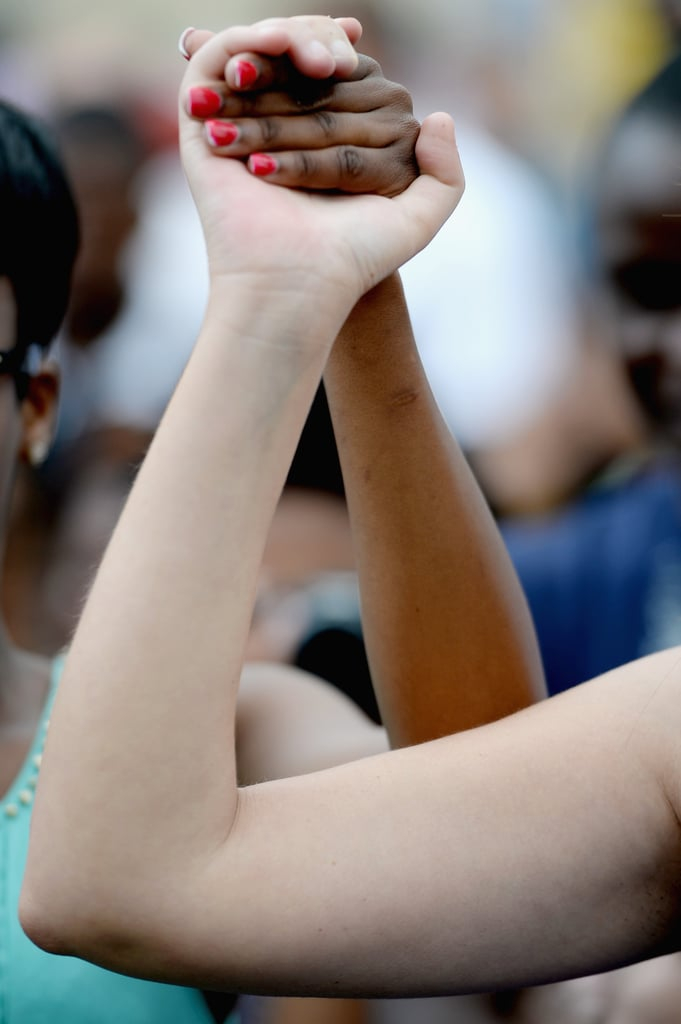 Two women held hands during a gathering outside Nelson Mandela's home.