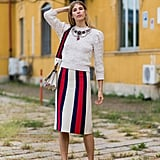 With a Striped Midi Skirt, Sweater, and Chunky Jewelry