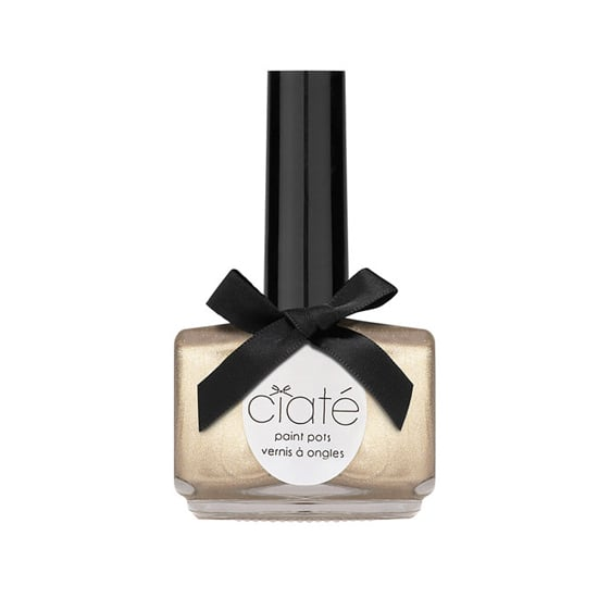 Have a sun-kissed glow? Why not add some radiance to your pedicure, too, with a scintillating shade of gold, like this Ciaté Paint Pot in Sand Dune ($15)?