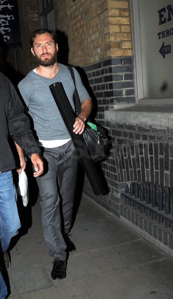 Jude Law carried bags leaving the theater in London.