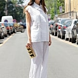 All it took was a gold clutch and mirrored shades to add interest to this all-white look.