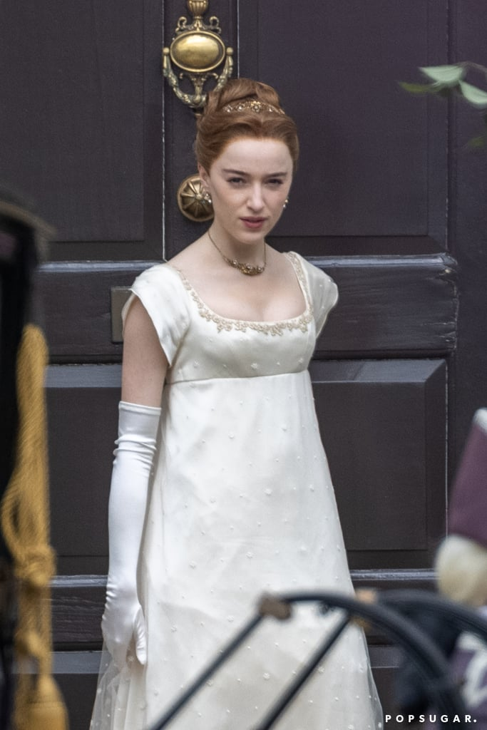 Daphne Bridgerton is back in action! On May 27, actress Phoebe Dynevor was spotted in London as the Netflix show gears up for season two. Her on-set appearance comes shortly after Jonathan Bailey and Sex Education's Simone Ashley filmed a scene as key love interests Sir Anthony and Kate Sharma. A few other newcomers to the show also made their debut, like Melissa Advani and Priya Kansara, who will play mother-daughter pair Lady and Miss Eaton.  This is the first time we've seen Dynevor step into Daphne's shoes since Regé-Jean Page announced he will not be returning to the Shondaland series for season two. Bridgerton's next installment will shift focus from Daphne and Simon to Kate and Anthony's romance, based on Julia Quinn's novel The Viscount Who Loved Me. We'll certainly miss the Duke of Hastings, but these behind-the-scenes pictures put us in the mood to read more of Lady Whistledown's musings. Season two can't come soon enough!       Related:                                                                                                           Regé-Jean Page's Bridgerton Exit Is Heartbreaking, but It's Also the Right Call