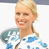 A low ponytail is already a simple style, but Karolina Kurkova gave her look a chic update with a deep side part and a bobby pin on one side.
