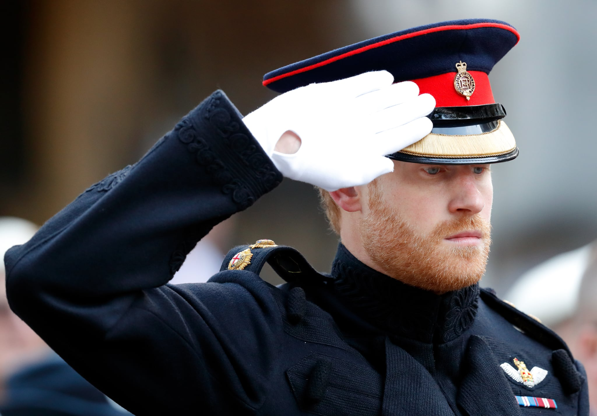 LONDON, UNITED KINGDOM - NOVEMBER 09: (EMBARGOED FOR PUBLICATION IN UK NEWSPAPERS UNTIL 48 HOURS AFTER CREATE DATE AND TIME) Prince Harry salutes as he visits the Field of Remembrance at Westminster Abbey on November 9, 2017 in London, England. The first Field of Remembrance was held in the grounds of Westminster Abbey in November 1928 when only two Remembrance Tribute Crosses were planted, but has now grown to approximately 70,000 crosses planted. (Photo by Max Mumby/Indigo/Getty Images)