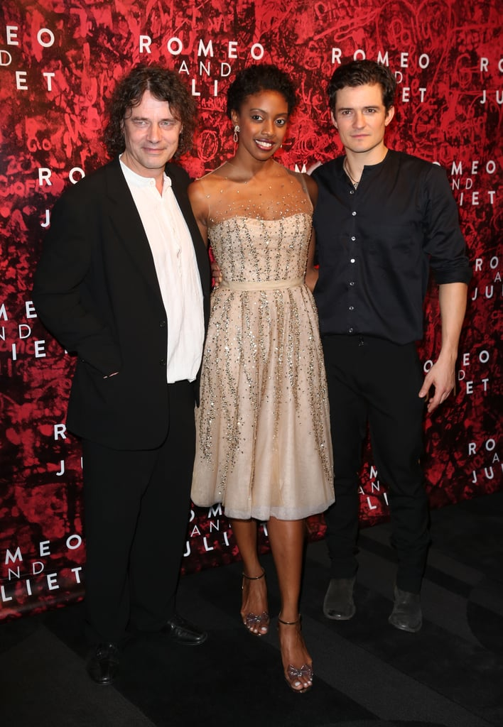 Orlando Bloom posed on the black carpet with director David Leveaux and his costar, Condola Rashad.