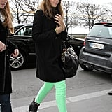 Jessica Alba showed off her lime-green jeans pared down with black.