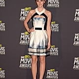 A shot of Emma Watson working the MTV Movie Awards red carpet in her Maxime Simoens dress.