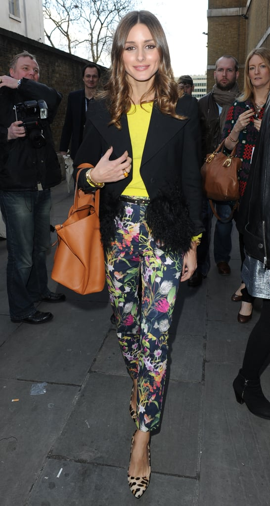 Olivia Palermo paired Topshop floral pants with a neon sweater and blazer to the Unique runway show.