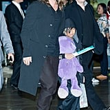 Brad Pitt and Pax huddled up to leave Seoul, South Korea, on Tuesday.