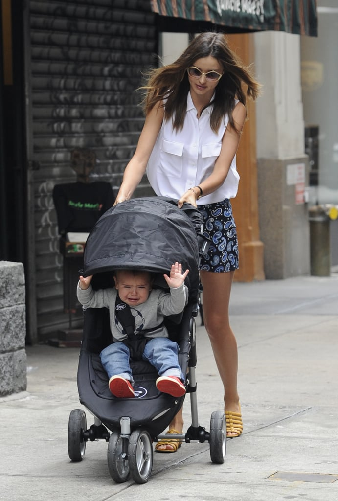 Miranda Kerr and Orlando Bloom's usually-smiley son Flynn seemed upset during a stroll with his mum on the streets of NYC yesterday! The one-year-old was in tears as Miranda tried to pull down the cover on his stroller. The Victoria's Secret model once said in an interview that she tried to shield him from photographers by putting a scarf over his stroller, but instead he pulled it up to make faces at paparazzi. That may have also been the case yesterday!