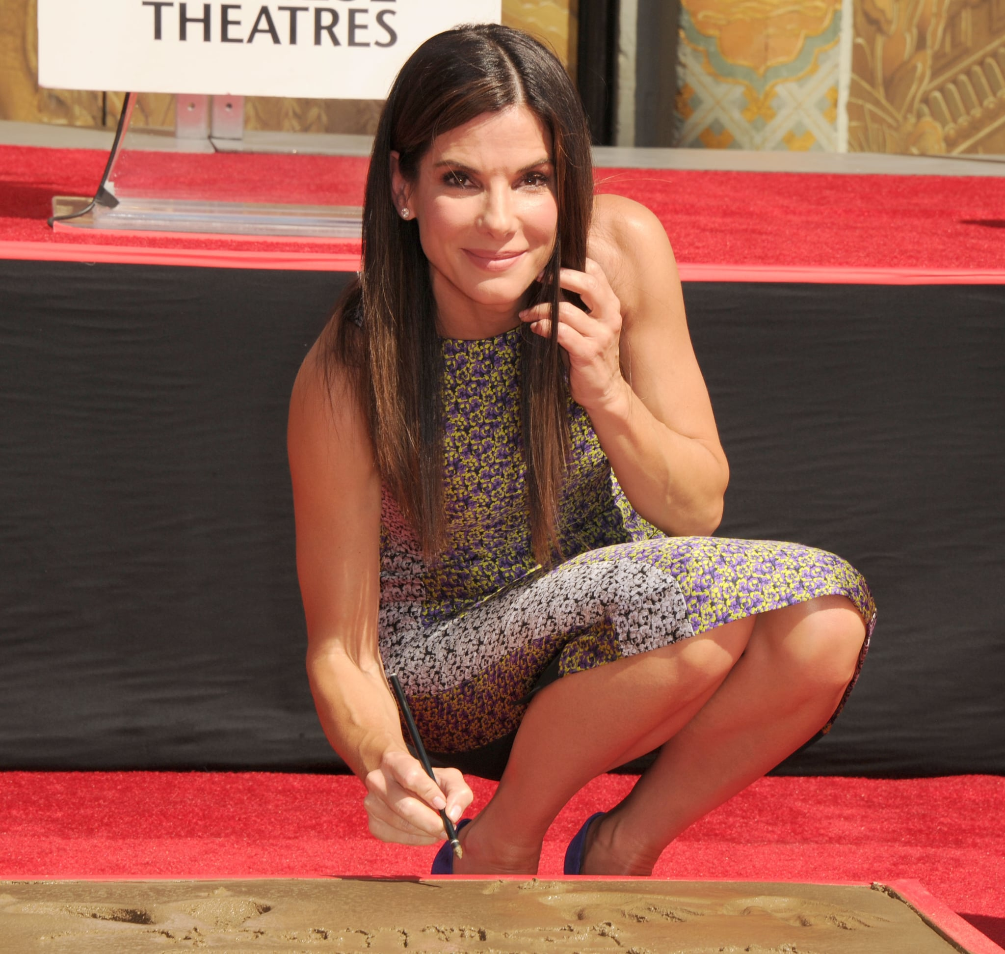 Sandra Bullock signed her slab at the TCL Chinese Theatre on Wednesday.