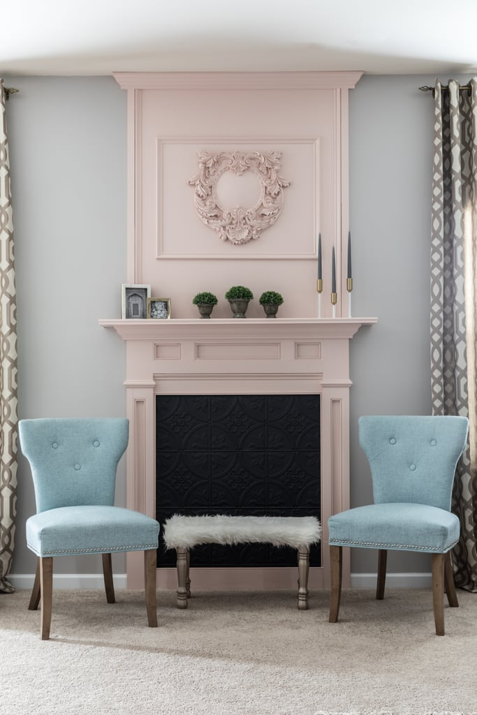 Monica created a stunning focal point from scratch by installing a faux fireplace. She painted it a subtly dramatic pastel pink and lined the back of the fireplace with tin-look tiles ($2 per square foot).
