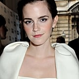 Opting for her usual gamine-sweet vibe, Emma Watson paired rosy cheeks and bold brows with a side-parted updo.