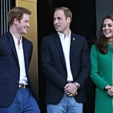 Prince Harry was all smiles with his brother and sister-in-law while watching Stage 1 of the Tour de France in Harrogate in July 2014.