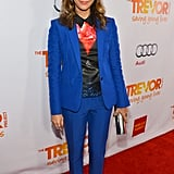 Rashida Jones went for color in a big way here, wearing a printed blouse with a bright blue pantsuit and neon pink heels.