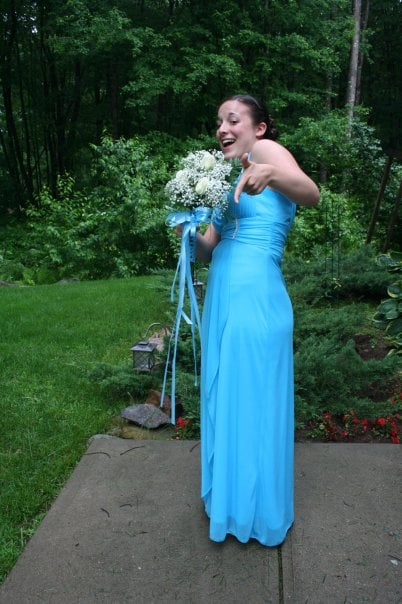 """""""Blue always has and always will be my favorite color, so I knew I had to wear a blue gown for my last big dance. This dress was one of the first I tried on — it was a perfect fit. The Grecian-style top really worked on my smaller bust, and the bottom flowed out just enough that I could comfortably bust a move on the dance floor. If I ever get married, I would love to wear a white version of this gown."""" — Leah Rocketto"""