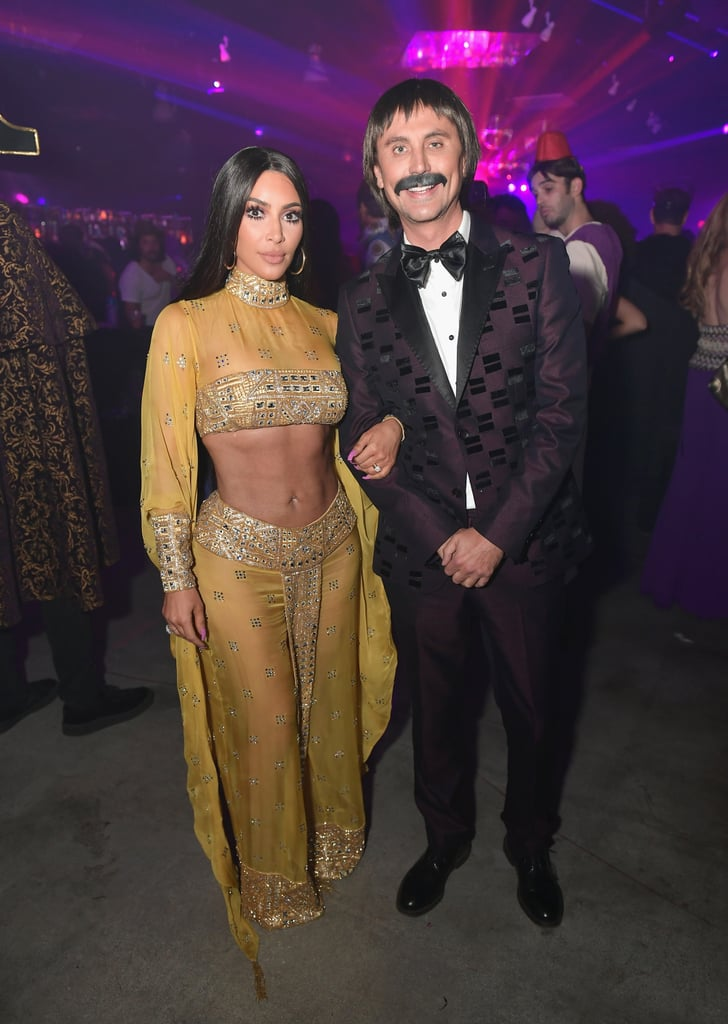 "Kim Kardashian turned heads when she arrived at the Casamigos Halloween party in LA on Friday night dressed up as the legendary Cher. The reality star, who has referred to Cher as her ""fashion icon"" in the past, paid homage to the Believe singer by re-creating her yellow embellished, two-piece look at the 1973 Oscars. Kim's best friend, Jonathan Cheban, also dressed up as Cher's ex-husband, Sonny Bono. On Saturday morning, Cher complimented Kim's sexy costume on Twitter, writing, ""Woke To See You Are Me 4 🎃 You Look BEAUTIFUL Little Armenian Sister💋"" Scroll through to see more photos of Kim's costume, then look back at her other most memorable Halloween costumes over the years.      Related:                                                                                                           These 2017 Celebrity Halloween Costumes Will Either Make You LOL or Scare the Sh*t Out of You"