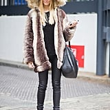 Bridget's style is equally bold on the street as it is on the red carpet. Here, she posed during London Fashion Week in a furry hooded coat, leather skinnies, and functional black booties.