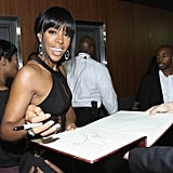 Presenter Kelly Rowland signed an autograph.
