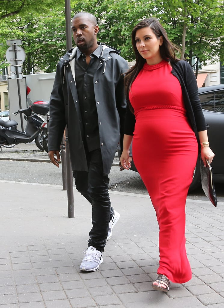 Pregnant Kim Kardashian flew to Paris to spend time with boyfriend Kanye West after a family vacation in Mykonos, Greece.
