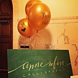 Love this idea from The Cream of calligraphy on balloons for table numbers or wedding pics.
