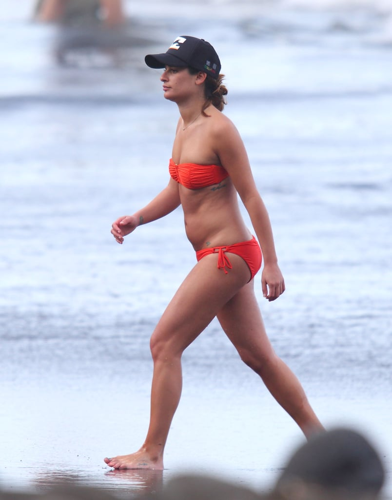 "Lea Michele hit the beach in a bikini while vacationing with boyfriend Cory Monteith in Hawaii on Tuesday. The Glee stars stood in the water and took photos of the scenery. They also took a tour by boat before walking back to their hotel hand in hand. Lea and Cory arrived on the island last week and rang in the New Year as a couple. They each tweeted photos while enjoying a fireworks display on the beach, with Lea adding that she was ""so excited for 2013.""  Both Lea and Cory seem to be having fun while on a break from shooting Glee, which is currently on hiatus until Jan. 24. The fourth season of the show has featured high-profile guest stars like Whoopi Goldberg, Sarah Jessica Parker, and Kate Hudson, though it hasn't been confirmed whether they'll be returning for the remaining episodes."