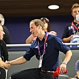 Prince William shook hands with Andy Hunt, the chef de mission of Great Britain.