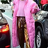 Gigi looked like a badass Barbie in a Christina Ledang puffer with pair of pleated printed pants from Christopher Bu. Gigi styled her sparkly pants with a pair of Filling Pieces biege kicks and mini Ilesteva sunglasses.