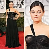 We thought Mila Kunis couldn't outdo herself after her amazing award season looks last year, but she's managed to prove us dead wrong. The actress and presenter wore a black chiffon dress from Christian Dior's Spring 2012 collection, and paired the gorgeous gown with Cartier jewels.