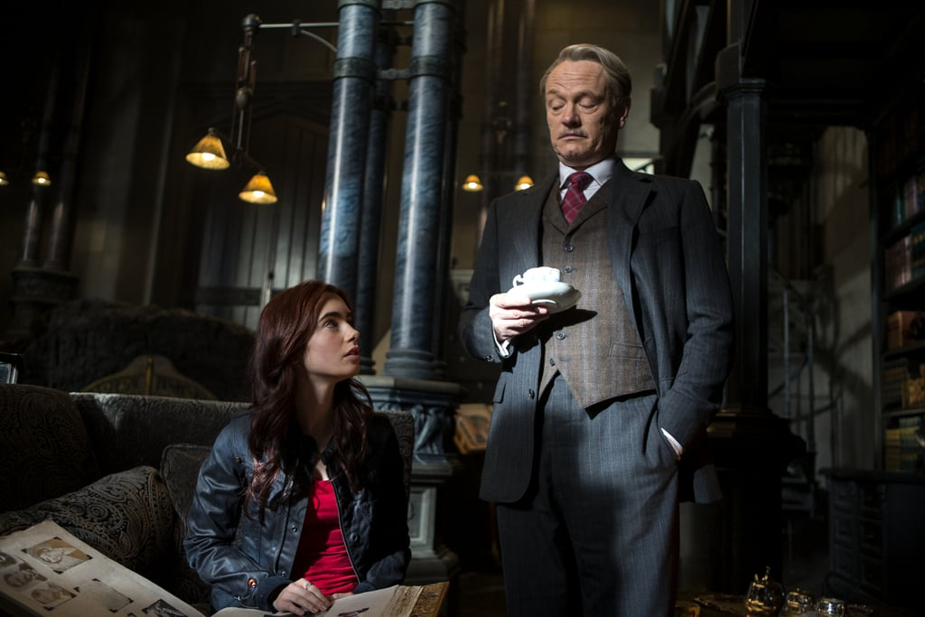 Lily Collins and Jared Harris in The Mortal Instruments: City of Bones.