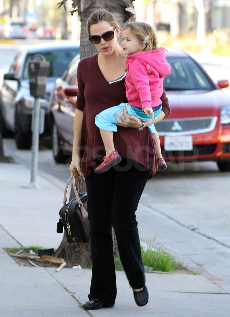 Jennifer Garner wore an Autumn Cashmere sweater at breakfast with family in LA this morning. The expecting mom carried Seraphina into the restaurant, and her dad, Bill Garner, carried the little one back outside afterward. Jennifer's been spending time with her loved ones as she nears the end of her pregnancy and has been out with husband Ben Affleck in recent weeks. The couple showed PDA in Santa Monica and also treated Violet and Seraphina to a post-Thanksgiving lunch. The foursome also have Violet's recent birthday to celebrate. We took a look back at Violet's adorable family moments to celebrate her turning 6 years old yesterday.