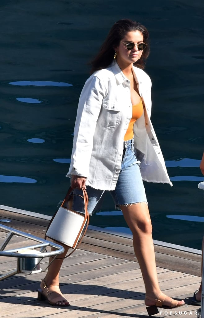 Selena Gomez in Orange Bodysuit and Denim Shorts in Italy
