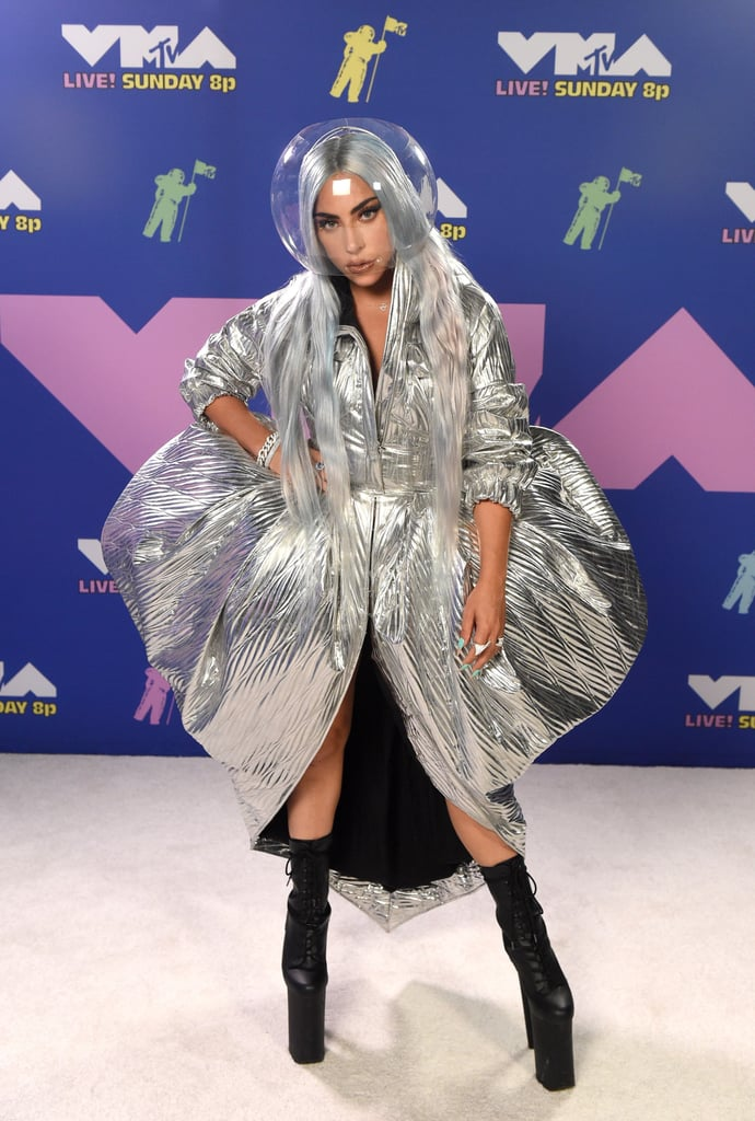 """Dress for the award you want — that's how the saying goes, right? Well, Lady Gaga must've gotten the message because she showed up to the MTV VMAs channelling full Moon Person energy, and we're here for it. The """"Rain on Me"""" singer is nominated for nine awards and is set to perform her hit single with Ariana Grande later in the Aug. 30 show, which is sure to be a must-watch.  We never know what we're going to get when Gaga takes the VMAs stage, but it's guaranteed to be entertaining! Fingers crossed she takes home a trophy tonight to match her look."""