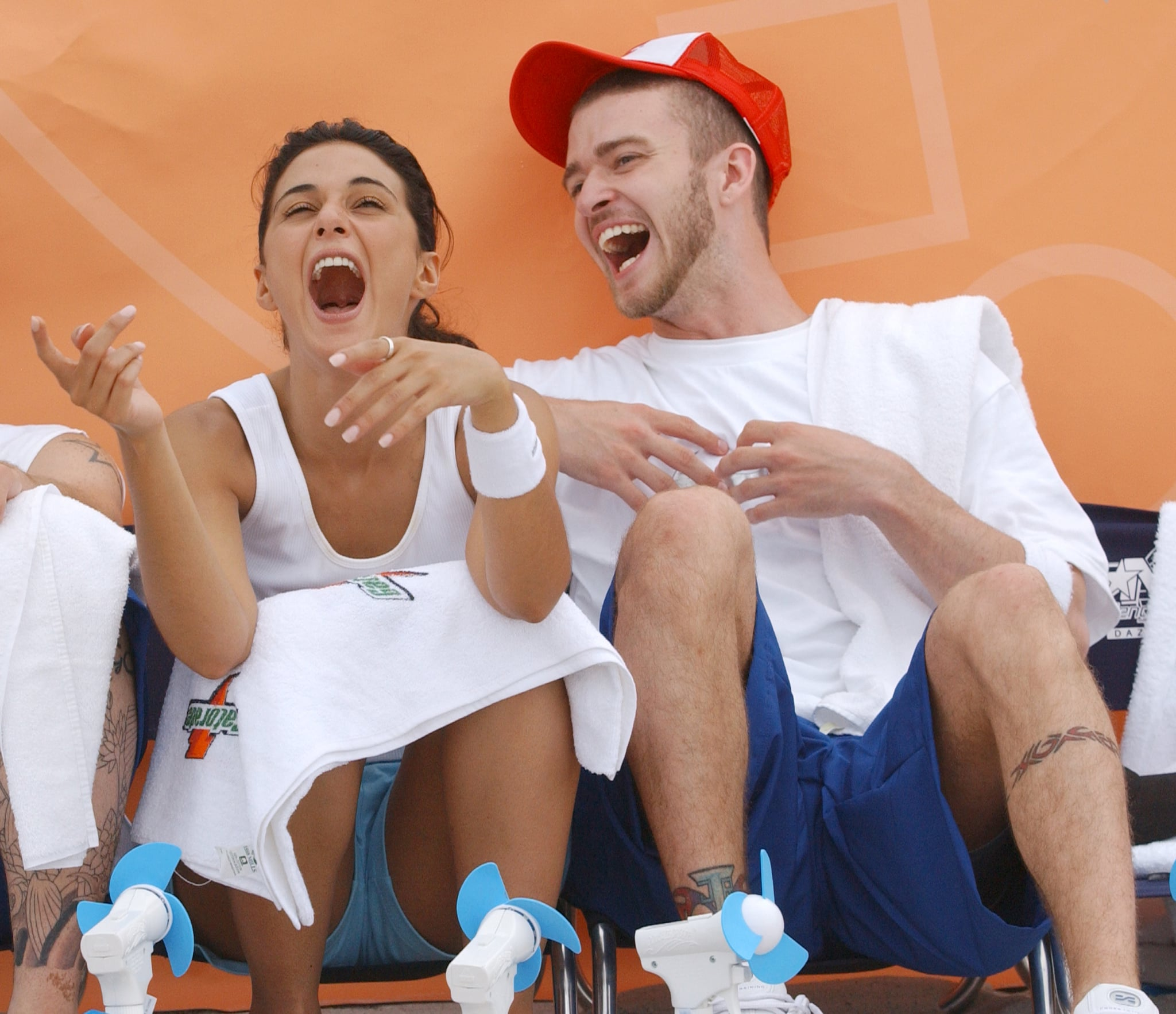 Emmanuelle Chriqui had Justin in stitches on Miami Beach during *NSYNC's charity event in July 2003.