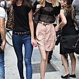 What's better than one street-chic look? Two, of course. This duo made their way to the shows in polished black tops and flats. Source: Greg Kessler