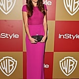 Nikki Reed nailed the pretty-in-pink look in this bright cap-sleeved gown at the InStyle party.
