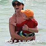 Reese Witherspoon cuddled with her son, Tennessee Toth, during a family vacation in Florida.
