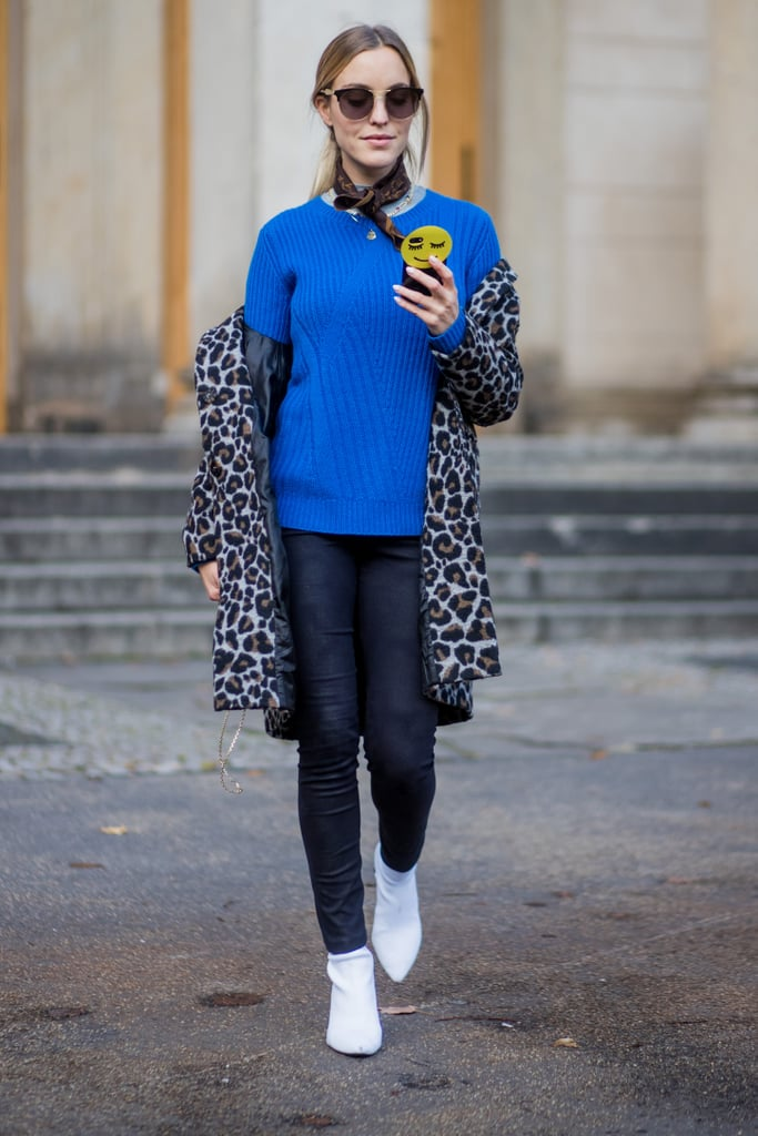 Keep it bold by pairing your skinny jeans with a bright blue sweater and leopard coat for colder days.