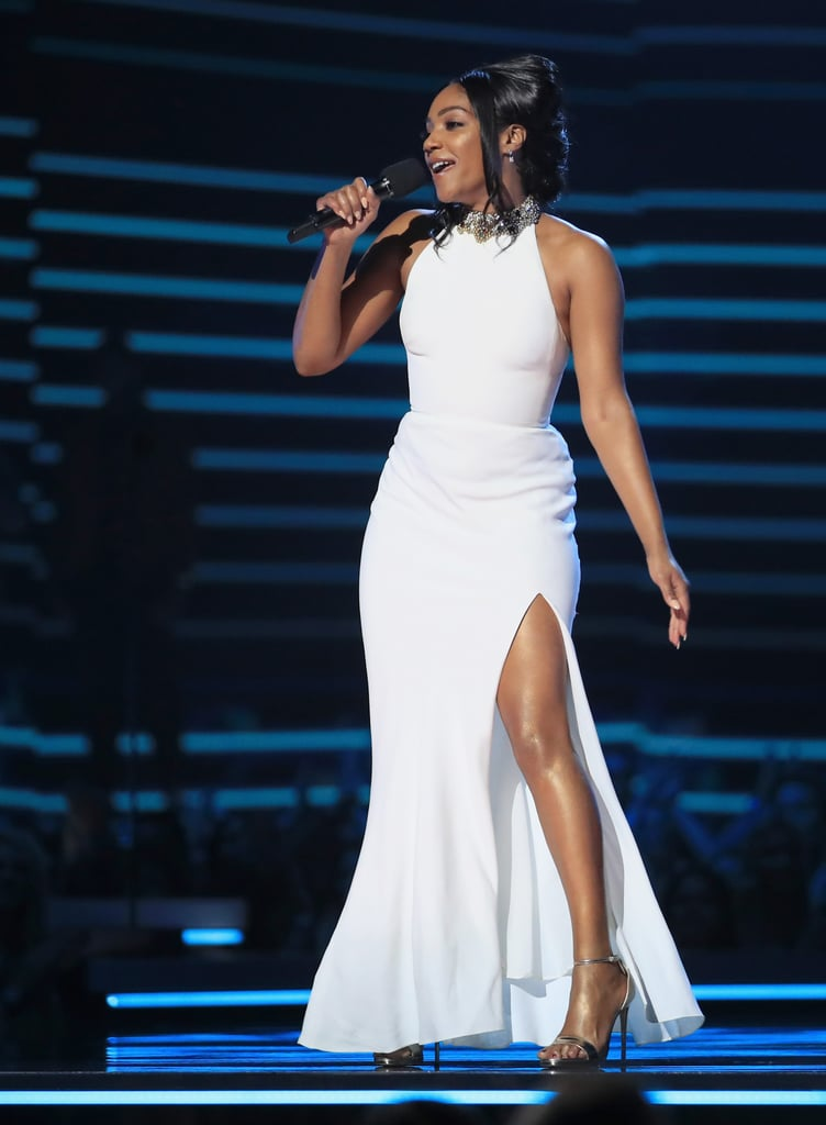 """OK, Tiffany Haddish, we bow down to you and your ability to bring back a stunning gown time and time again. While the 38-year-old comedian hosted the MTV Movie & TV Awards, she had a number of outfit changes, which included a quick slip back into a timeless classic: her white Alexander McQueen dress.  Does the white gown look familiar? Well, that's because Tiffany has actually sworn to wear this sleek dress """"multiple times,"""" and she's already broken it out, not once, not twice, but three times before, most recently at the Oscars in March. This time around, however, she paired the dress with her silver strappy heels instead of her comfy UGG slippers. Find yourself an icon who can do both. Ahead, see the dress from all angles during Tiffany's night of hosting.       Related:                                                                                                           Kim Kardashian Walked the Red Carpet With Her Mum But It Was Her Sexy Outfit That Stole the Show"""