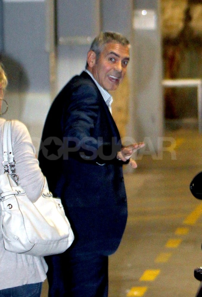 George Clooney smiled after touching down in Sydney.