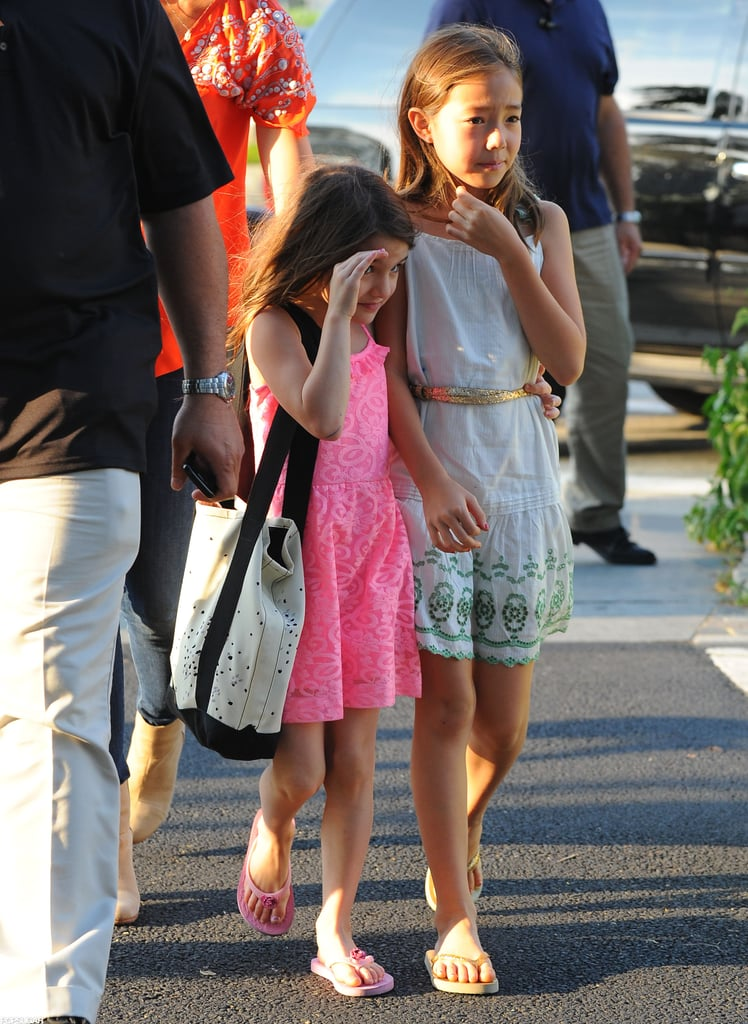 Suri Cruise peeked out from under her hands.